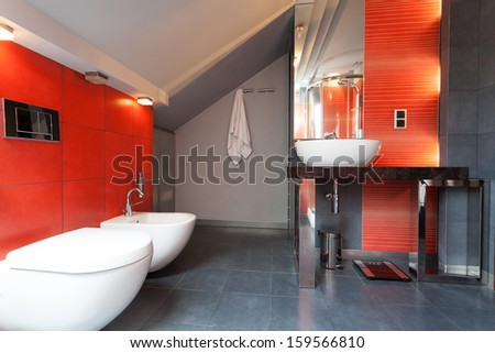 Red and grey bathroom with wc and bidet
