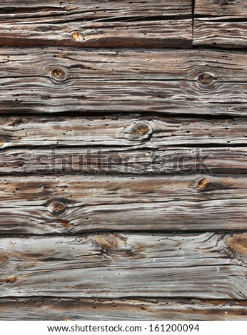 Red and grey old planks with holes and cracks placed horizontally. - stock photo