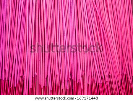 red and magenta incense sticks in a temple - stock photo
