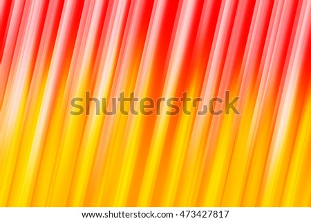 Red and orange blurred rays of light blend to create abstract background