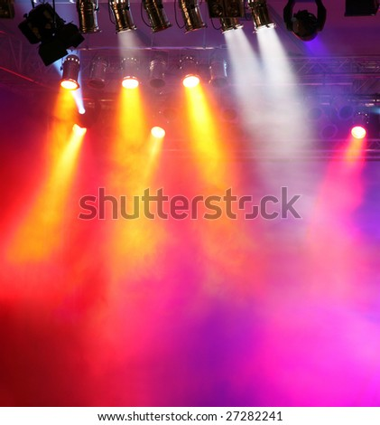 Red and orange spotlights with smoky air as background - stock photo