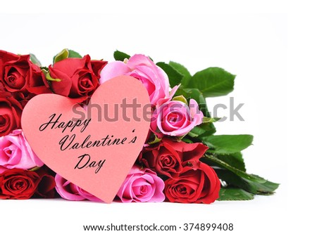 Red and pink roses with heart shaped Valentine's card isolated on white