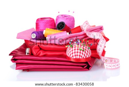 red and pink thread, measuring tape and fabric isolated on white - stock photo