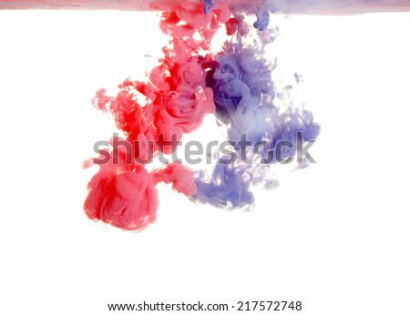 Red and purple paint in water, an abstract on a white background  - stock photo