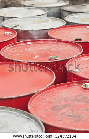 Red and silver colored empty oil-drums - stock photo