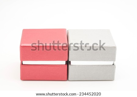Red and silver hard paper box for gift or present as isolated objects on white background