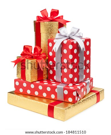 Red and striped and gold boxes with gifts tied bows on white background  - stock photo