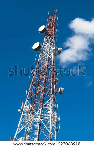 Red and white antenna on blue sky