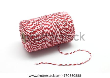 Red and white baker's twine spool isolated on white background - stock photo