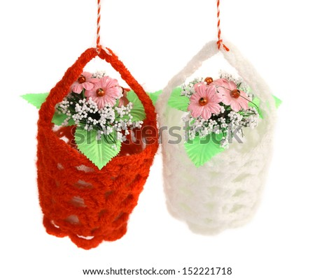 Red and white baskets of flowers. - stock photo
