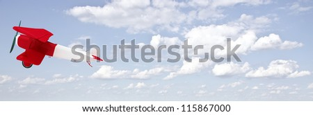 red and white biplane in the sky with clouds