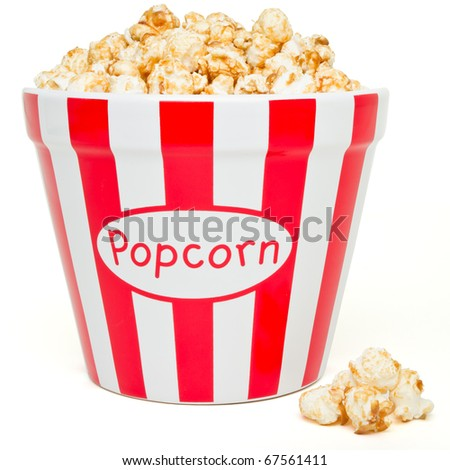 red and white bowl of popcorn from low perspective isolated on white. - stock photo
