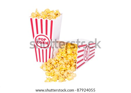 Red and white boxes of yellow popcorn on a white background
