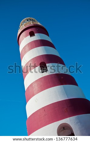 Red and white candy cane striped lighthouse on Elbow Cay, Abaco, Bahamas, Hope Town - stock photo