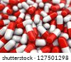 Red and white capsules - stock photo