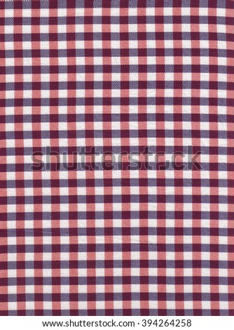 Red and white checkered fabric as background texture. Red classic checkered tablecloth texture - stock photo