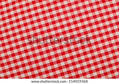 Red and white checkered fabric, traditional picnic tablecloth - stock photo