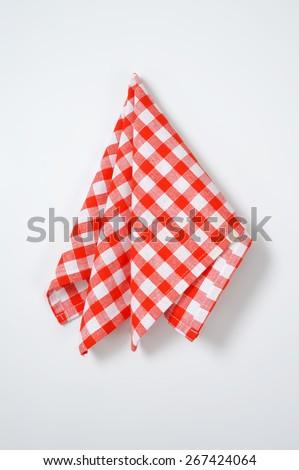 red and white checkered napkin on white background - stock photo