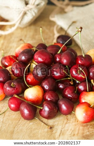 Red and white cherries on a wooden cutting board