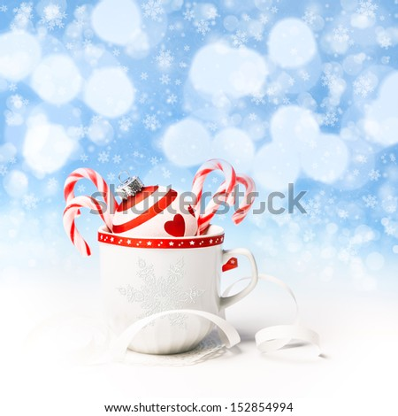 Red and white Christmas decorations on abstract winter background - stock photo
