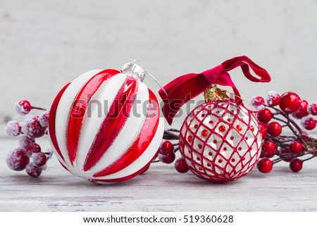 red and white christmas - decorations on aged wooden background with copy space