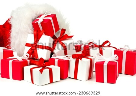 Red white christmas gift boxes spilling stock photo 230669329 red and white christmas gift boxes spilling from a santa bag over a white background negle Image collections
