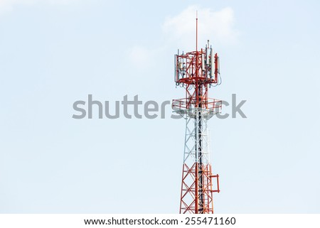 Red and white color antenna repeater tower on blue sky - stock photo