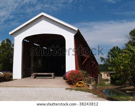 Red and white covered bridge in Indiana. - stock photo