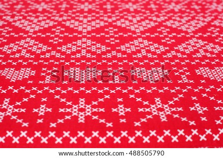 red and white criss-cross pattern background