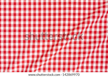Red and white gingham tablecloth texture background  - stock photo