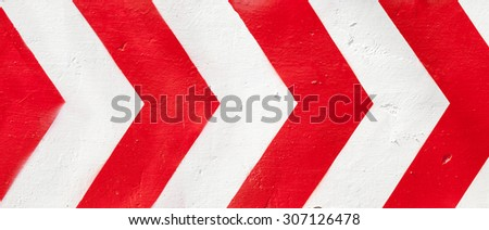 Red and white grunge warning stripes background.