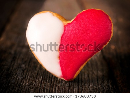 Red and white heart shape cookies on the wooden table - stock photo