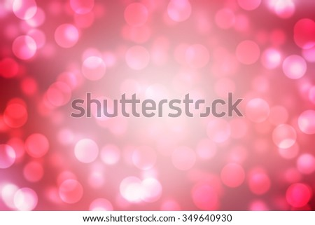 Red and white holiday bokeh. Abstract Christmas background.