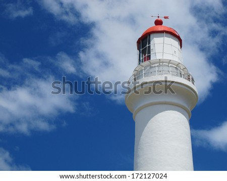 Red and White Lighthouse Against Sky - stock photo