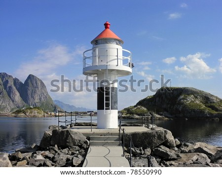 Red and white Lofoten lighthouse in norwegian sea, Norway - stock photo