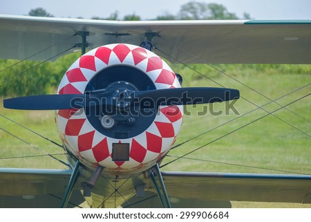 Red and white painted cowling on an old and restored antique WWI airplane - stock photo