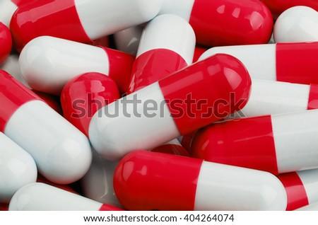 Red and White Pills closeup - stock photo