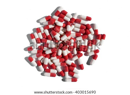 Red and white pills on a white background