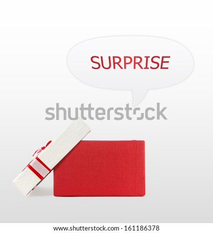 red and white present wrap by ribbon on bright background with clipping path. Include text surprise. - stock photo