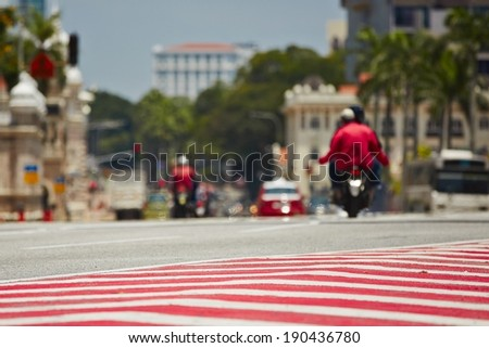 Red and white sign on the street (Kuala Lumpur, Malaysia) - selective focus - stock photo