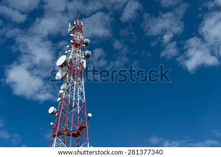 Red and White Signal tower with clear blue sky - stock photo