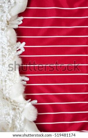 Red and white stripe background for text decorated with white fabric