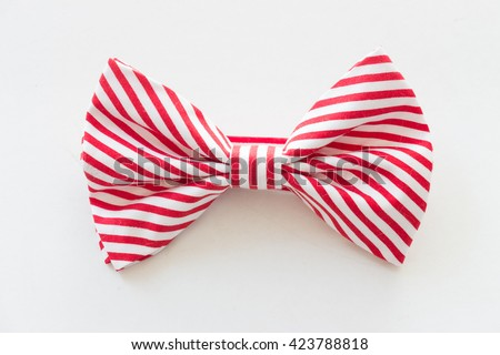 Red and white stripe bow tie isolated on white background - stock photo