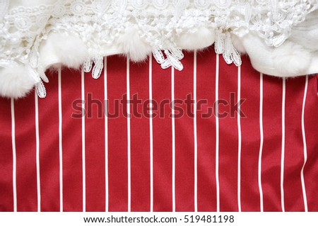 Red and white stripe copyspace decorate with white fabric on top