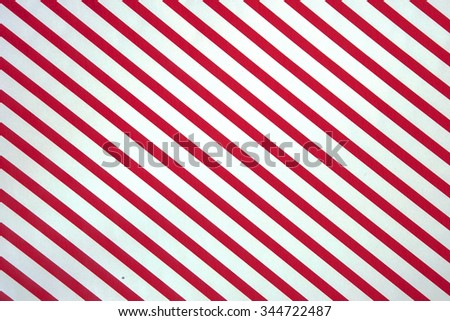 Red and white striped Christmas background with copy space