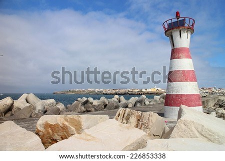 Red and white striped lighthouse in Peniche, Portugal - stock photo