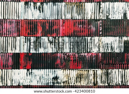 Red and white stripes hand painted on  a rusty fenc. Fragment of stylized image of the American flag  - stock photo