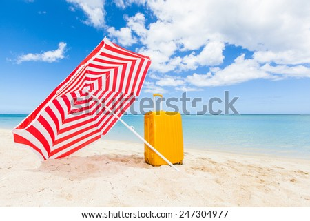 red and white sunshade and yellow trolley at the beach, Le Morne, Mauritius, Africa
