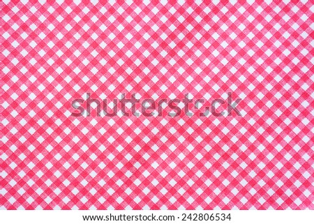 Red and white tablecloth background. - stock photo