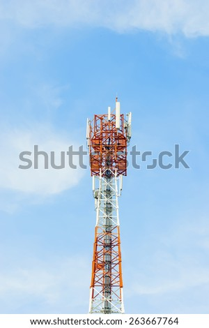 Red and White Telecommunication tower with blue sky and cloud - stock photo